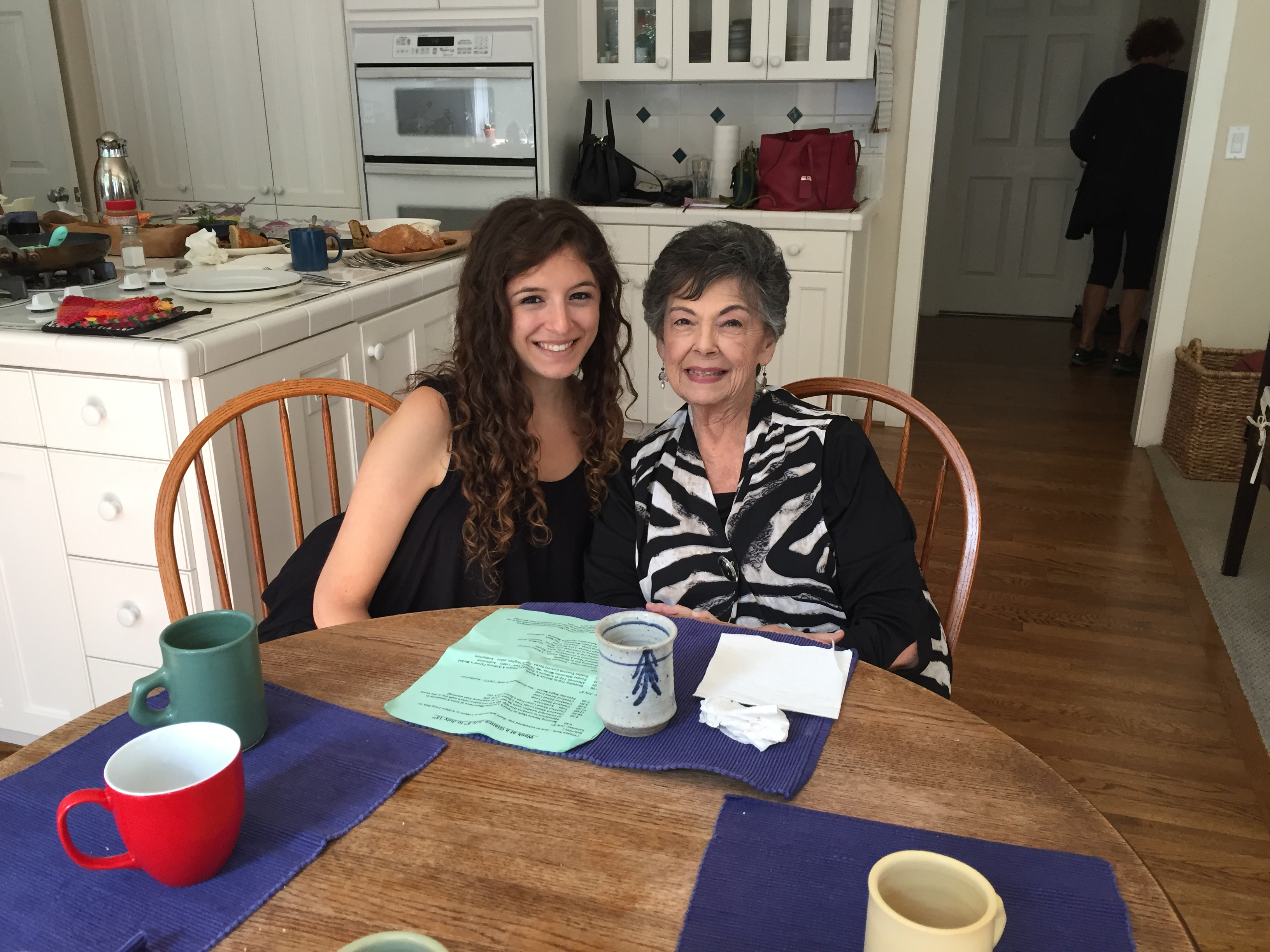 CSPI policy associate Jessi Silverman seated next to her grandmother in a kitchen.