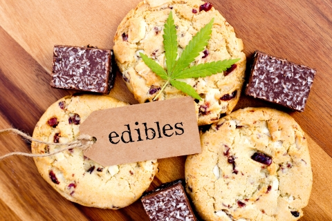 "Cookies and brownies labeled ""edibles"" with a marijuana leaf"
